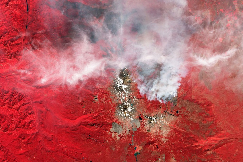 Smoke and ice in the Cascade Mountains, USA. Photo: NASA