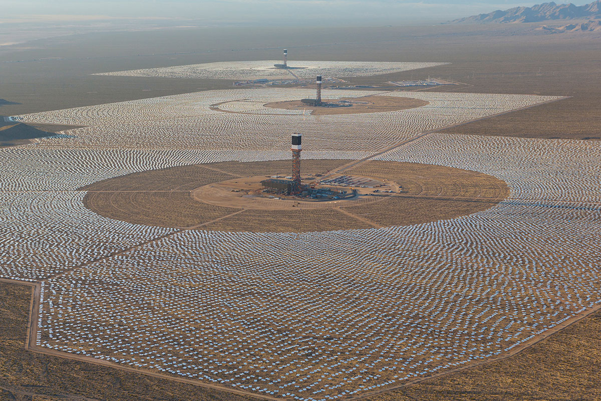 An aerial view of the Ivanpah Solar Electric Generating System with Tower 3 in the foreground, Tower 2 in the middle and Tower 1 in the background. The towers are surrounded by 173,500 heliostats that follow the sun's path.(Photo: Business Wire)